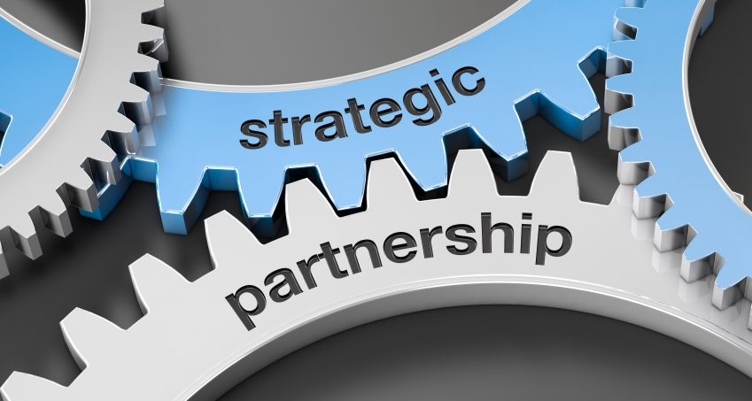 Gears with the text strategic partnership