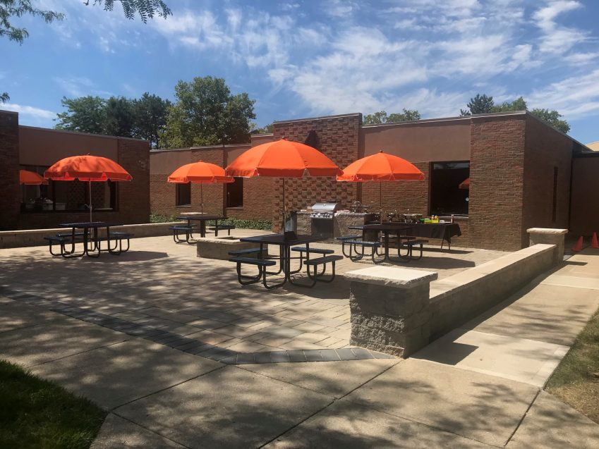 STI-TEC Outdoor Patio with Tables and Umbrellas